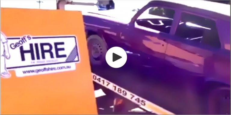 video screenshot of car going trailer